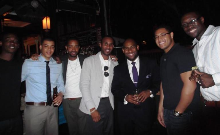 """What I see in this pic: The guy with the suit on is everyone's boss. Not only is he sporting a suit, he has that square that says """"You all may be lottery picks with big contracts, but I pay you....outta my pocket!""""  This couldn't be any further from the truth. Dorian Spence is just like the rest of us....bosses! But he's the only one dope enough to dress like it."""